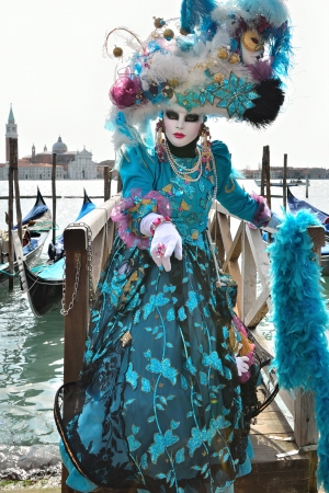 VENICE - MARCH 7: An unidentified masked person in costume in St. Mark's Square during the Carnival of Venice on March 7, 2011. The 2011 carnival was held from February 26th to March 8th. Stock Photo - 14041507