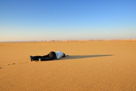 Thirst, woman in the desert, Sahara photo