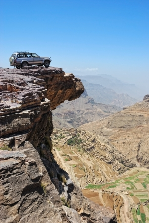 Over land. Lone car is standing on the rock over breakaway Stock Photo