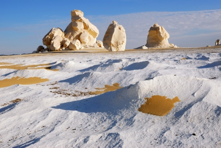 Golden sand on the white marl and limestone formations