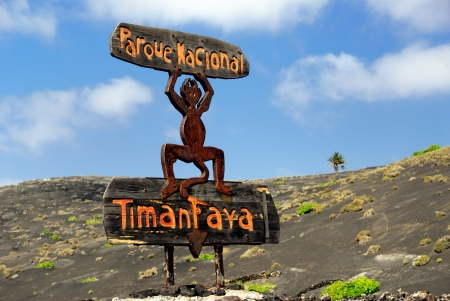 timanfaya: National Park of Timanfaya sign, most popular site on Lanzarote,  this land was born of hundreds of fire-spitting volcanos  Canarian island, Spain