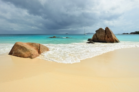 Tropical sand beach with granite rocks on Seychelles islands, Praslin, Anse Lazio