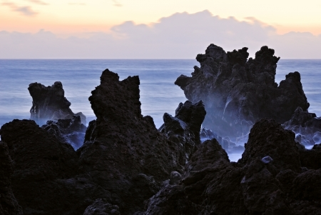 los hervideros: Unusual forms of volcanic cliffs of lava on the rocky shore  Beautiful sunset over the Atlantic Ocean  Los Hervideros, Lanzarote, Canary Islands