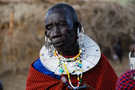 NGORONGORO CONSERVATION AREA, TANZANIA - JANUARY 24: Unidentified African woman from Masai tribe on January 24, 2008. Old woman in a traditional African dress and decorations Stock Photo - 14142991