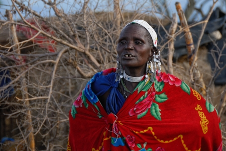 NGORONGORO CONSERVATION AREA, TANZANIA - JANUARY 24: Unidentified African woman from Masai tribe on January 24, 2008. Old woman in a traditional African dress and decorations  Editorial