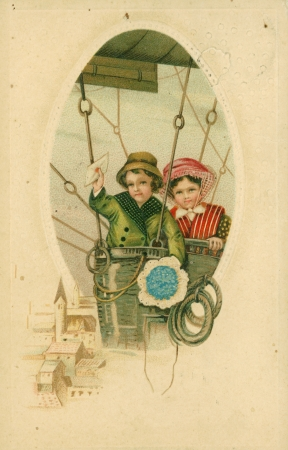 GERMANY - CIRCA 1913: Vintage postcard depicts two children in an air balloon, circa 1913, Germany. A little boy holds an envelope in his raised hand in the other hand a bouquet of flowers, standing next to his sister