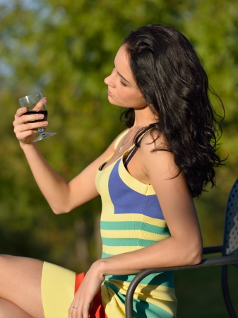 Sensual beautiful girl  with glass of red wine outdoors photo