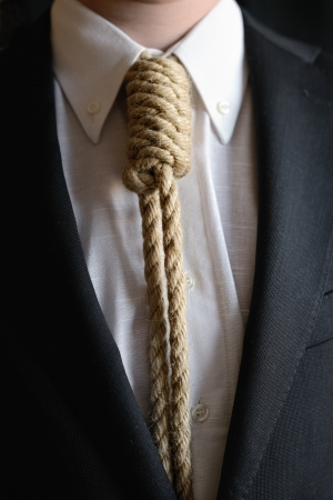 bondage: Detail of businessman with hangman noose instead of tie symbolizing economic problems Stock Photo