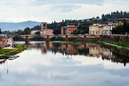 sightseeng: View on the Arno River in Florence at evening time, Italy
