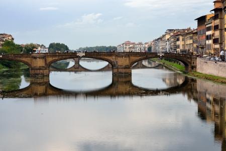 sightseeng: FLORENCE, ITALY - OCTOBER 11  Ponte Santa Trinita bridge over the Arno River  The Ponte Santa Tr&Atilde,&not,nita is the oldest elliptic arch bridge in the world   On Oct 11, 2012 in Florence, Italy Editorial