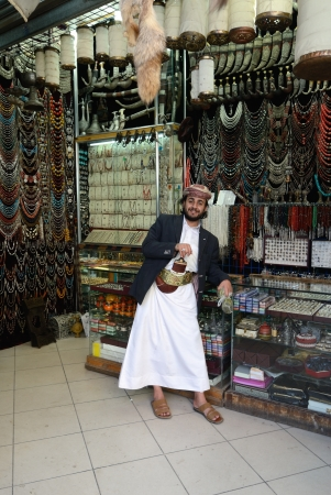suq: SANAA, YEMEN - MARCH 6: An unidentified man poses in front of a jewellery store on Mar 6, 2010 in Sanaa, Yemen. Open markets play a central role in the social-economic life of one of the poorest countries in the World