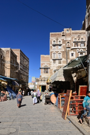 SANAA, YEMEN - MARCH 6: Typical street in old city shown on Mar 6, 2010 in Sanaa, Yemen. Inhabited for more than 2.500 years at an altitude of 2.200 m, the Old City of Sanaa is a UNESCO World Heritage City. Stock Photo - 18560127