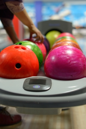 bowling strike: Bowling ball machine with person taking ball in the background