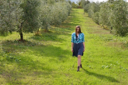 agriturismo: Agritourism. Beautiful young country girl in olive garden. Tuscan, Italy