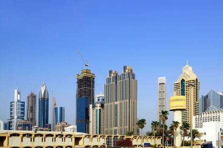 DUBAI - SEP 01: Dubai skyscrapers on Sheikh Zayed Road on September 01, 2010 in Dubai. The highway runs parallel to the coastline to the border with Abu Dhabi. It is home to most of Dubai skyscrapers  Stock Photo - 20289693