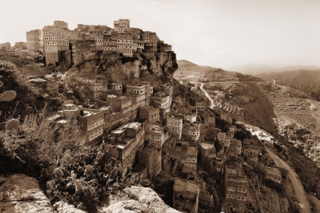 Al Hajarah is one of the finest examples of a mountain top fortified village  Once Consisting of a gated Muslim village with a Jewish settlement  Sepia Stock Photo - 20408522