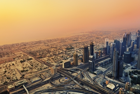 DUBAI - SEP 01  Dubai skyline along Sheikh Zayed Road at sunset on Sep 1, 2010,  Dubai, UAE  It is home to most of Dubai Éditoriale