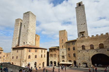SAN GIMIGNANO, ITALY - OCT10  Tourists in the small medieval town with many medieval Skyscrapers - towers, it is a famus Unesco World Heritage site in Tuscany, October10 2012 in San Gimignano, Italy  Stock Photo - 22234443