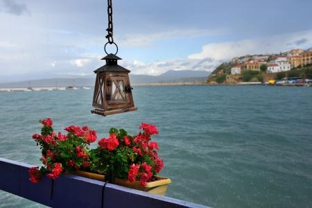 messenia: The town of Pylos under rain. Street torch and flowers on balcony. Messenia, Navarino bay, Greece