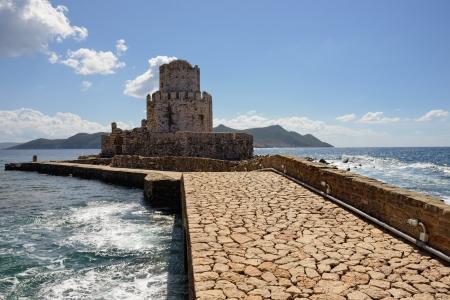 bourtzi: Bridge to the Bourtzi tower in Methoni Venetian Fortress in the Peloponnese, Messenia,  Greece. Stock Photo