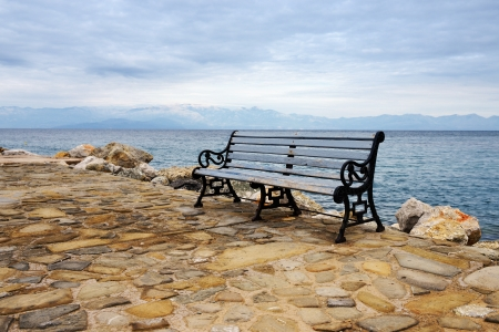messinia: Lonely old bench on seafront against greek seascape  Greece, Koroni