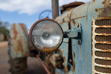 The headlight of abandoned rusty vintage tractor  Small depth of field Imagens