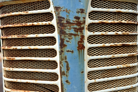 The close up front view of a vintage tractor grill photo