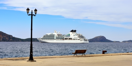 GREECE, PYLOS - 26 SEP  Cruise ship Seabourn Odyssey shown in Navarino bay on sep 26, 2013  Built in 2009 in Genoa  Although, at 32,000 GRT and length 650 feet, it accommodates just 450 guests in 225 luxury suites