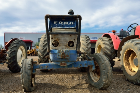 GIALOVA, GREECE - OCT 9  Old Ford tractor shown at a junkyard on oct 9 2013 in Greece  First Ford tractor was made  in 1916   In 1991 Ford sold its tractor division to Fiat with the agreement that they must stop using the Ford name by 2000