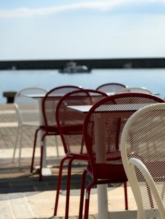 messenia: Empty seafront cafe in Kalamata harbor, Messenia, Peloponnese, Greece