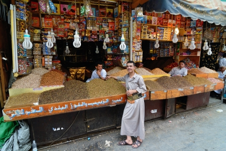 suq: SANAA, YEMEN - MARCH 6  Unidentified men sell dried fruits on Mar 6, 2010 in Sanaa, Yemen  Open markets play a central role in the social-economic life of one of the poorest countries in the World