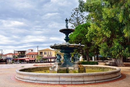 messinia: Central square of Filiatra with main city attraction - antique bronze fountain ordered in 1871 in Firenze, Messinia, Greece