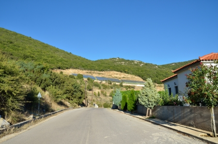Greek countryside  Empty road along traditional village  Messinia photo