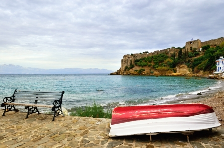messinia: Fishing boat on seafront of medieval town of Koroni at evening time, Greece Stock Photo