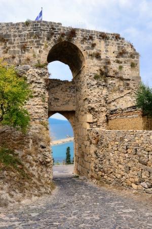 messinia: View of Koroni harbor through Koroni castle enteryway, Messinia, Greece