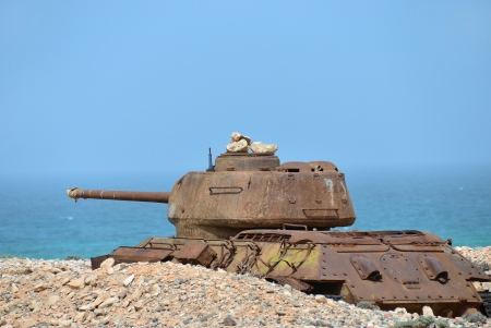 Rusty soviet battle tank T-34 on the shore of Indian ocean at the Socotra Island, Yemen  photo