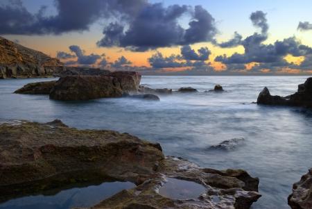 golfo: El Golfo beach in a cloudy sunset in Lanzarote, Canary islands