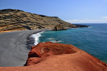 Lanzarote, black sandy beach in gulf of El Golfo,  Atlantic ocean near Lago de los Clicos in Canary Islands  Imagens