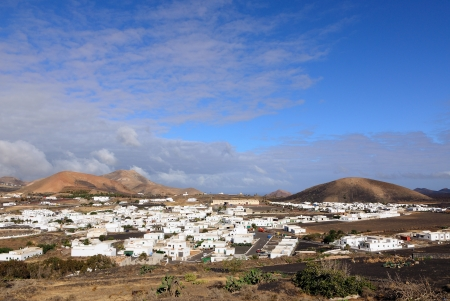 Beautiful village Yaiza with view to the volcanoes of Lanzarote Stock Photo - 25317358