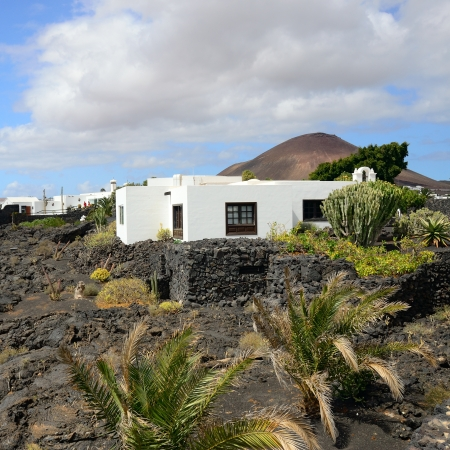 spanish houses: Typical  spanish houses on lava field  in Tahiche, Lanzarote, Canary Islands Stock Photo
