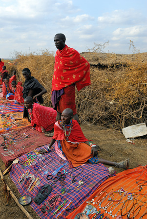 traditional goods: MASAI MARA, KENYA - AUG 23  Local sellers from Masai tribe offer goods in the market, on Aug 23, 2010 in Masai Mara  Traditional handmade accessories very popular souvenir from Kenya for most tourists