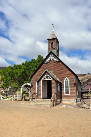 Old protestant church in wild west town photo