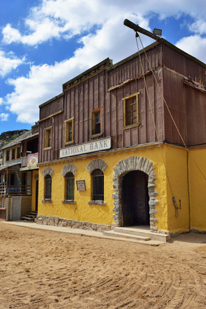 sioux: SIOUX CITY, GRAN CANARIA -  FEB 20, 2014: Street of wild west town with bank building in Sioux City. Popular tourist attraction in Gran Canaria island Editorial