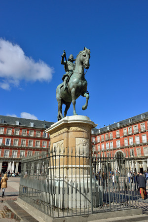 MADRID, SPAIN - MARCH 3, 2014  Plaza Mayor with statue of King Philips III in Madrid  Madrid is a popular tourism destination with average about of 4 million estimated annual visitors