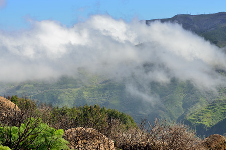 Beautiful Gran Canaria  landscape  Big cloud in blue sky above mountains  Canary island, Spain photo