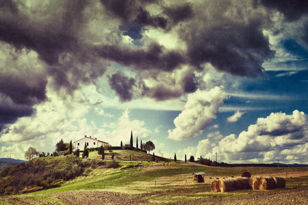 Rural landscape with farmhouse, plow and stack of hay  Tuscan, Italy  Filtered image  photo