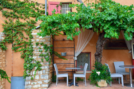 Typical street cafe in beautiful medieval village Roussillon, Provence, France photo