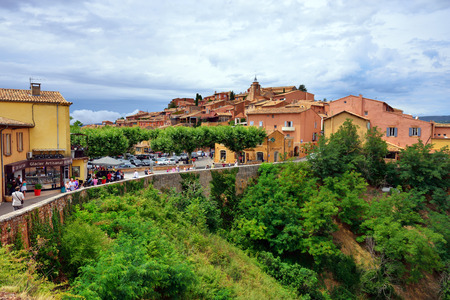 roussillon: ROUSSILLON, FRANCE - JUL 07, 2014  View on beautiful medieval village of Roussillon  Roussillon ocher village is included in list of  The most beautiful villages of France  Editorial