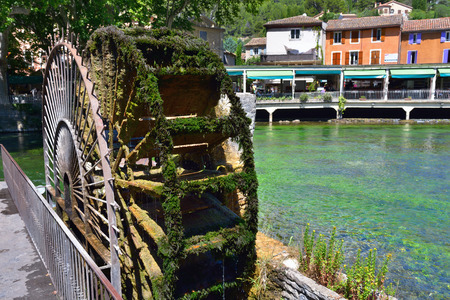 fontaine: Beautiful Medieval Village Fontaine de Vaucluse on the river shore, Provence, France.The poet Petrarch made it his preferred residence in the 14th century Stock Photo