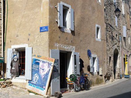cited: BONNIEUX, FRANCE - JUL 11, 2014: Decorated shop on the  street of the beautiful medieval village of Bonnieux. Bonnieux village is included in list of \The most beautiful villages of France\ Editorial